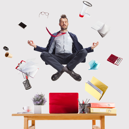 The young zen businessman relaxing at office in yoga pose lotus Stock fotó - 109606488