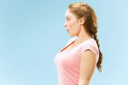 Beautiful female half-length portrait isolated on blue studio backgroud. Stockfoto