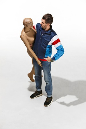Fashion woman body. The man hugging mannequin at studio, perfect woman dream concept