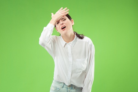 Why is that. Beautiful female half-length portrait isolated on trendy green studio backgroud. Young emotional surprised, frustrated and bewildered woman. Human emotions, facial expression concept.