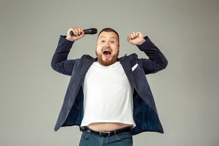 Young man with microphone Stock Photo