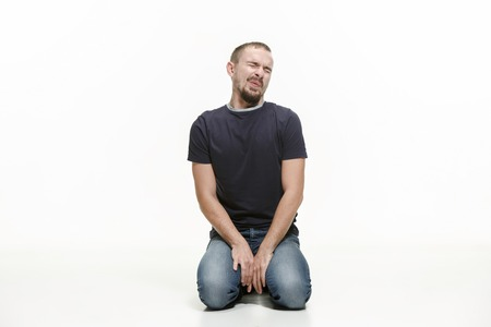 very disappointed man isolated on white studio background