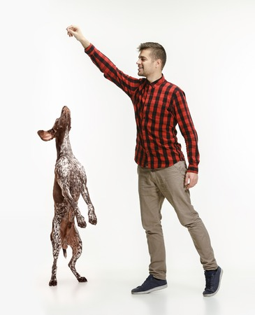 Emotional Portrait of man and his dog, concept of friendship and care of man and animal. German Shorthaired Pointer - Kurzhaar puppy dog isolated on white studio background Stok Fotoğraf