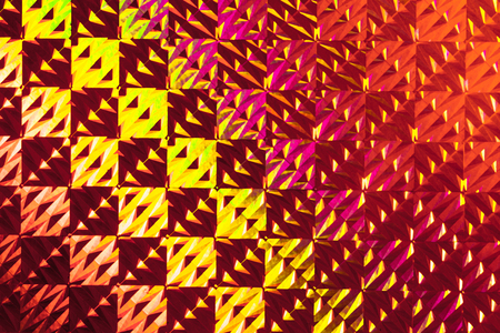 Texture of colored foil with holographic effect. Christmas, New Year, holiday, festival, carnival background