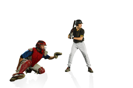 The fit caucasian men baseball players playing in studio. silhouettes isolated on white background