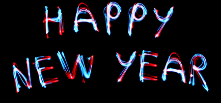 NEW YEAR CELEBRATTION concept. 2019 HAPPY NEW YEAR text fluorescent Neon tube Sign on dark brick wall. Front view. Banque d'images