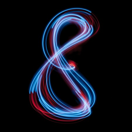 The neon number 8, blue light image, long exposure with colored fairy lights, against a black background