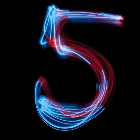 The neon number 5, blue light image, long exposure with colored fairy lights, against a black background Stock fotó