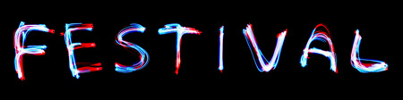 Red neon sign of festive greetings. blue light image, long exposure with colored fairy lights, against black