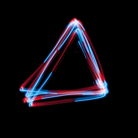 The neon triangle on black. multicolor led light painting or abstract background