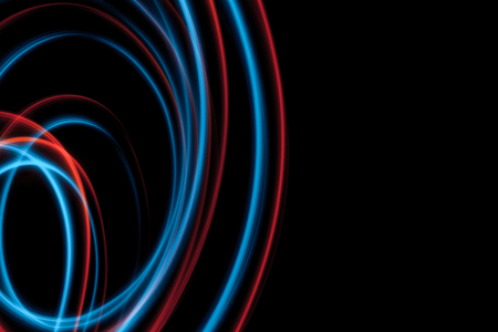 multicolor led light painting round trails abstract background on black Stock Photo