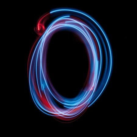 Letter O of the alphabet made from neon sign. The blue light image, long exposure with colored fairy lights, against a black background