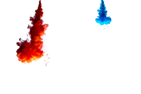 abstract formed by color dissolving in water over white background