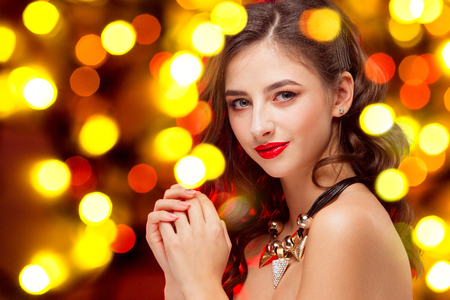 Beautiful girl and shiny background with lights . Celebration of New Year and Christmas, white wine and excitement