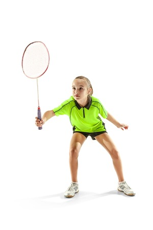The one caucasian young teenager girl playing badminton at studio. Stock Photo