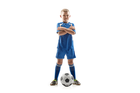 Young fit boy with soccer ball standing isolated on white. The football soccer player on studio background. Stockfoto - 113093979