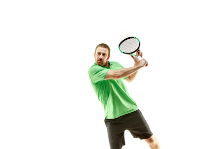 The one caucasian man playing tennis isolated on white background. Studio shot of fit young player at studio in motion or movement during sport game.. Stockfoto