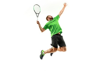 The one caucasian man playing tennis isolated on white background. Studio shot of fit young player at studio in motion or movement during sport game.. Foto de archivo