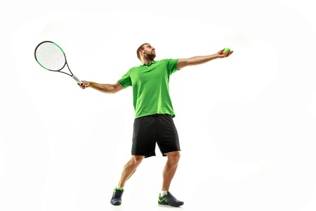 The one caucasian man playing tennis isolated on white background. Studio shot of fit young player at studio in motion or movement during sport game.. 写真素材