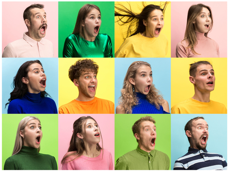 The surprised and astonished young woman and man screaming with open mouth isolated on colorful background. concept of shock face human emotion 免版税图像