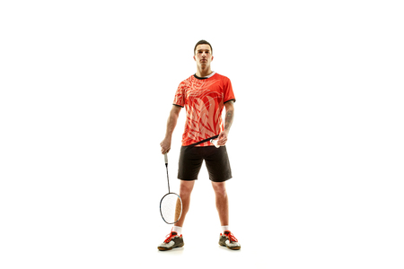 Young man badminton player standing over white studio background. Fit male athlete Stock Photo