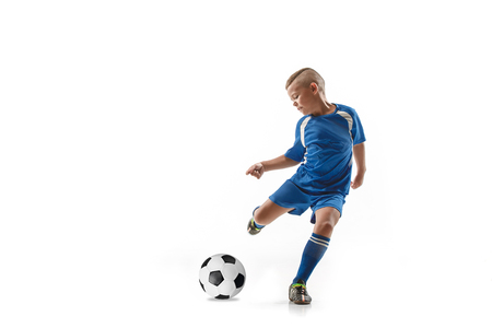 Young boy with soccer ball doing flying kick, isolated on white. football soccer players in motion on studio background. Fit jumping boy in action, jump, movement at game. Reklamní fotografie
