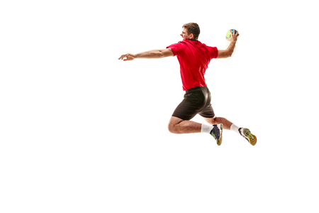 The fit caucasian young male handball player at studio on white background. Fit athlete isolated on white. The man in action, motion, movement. attack and defense concept