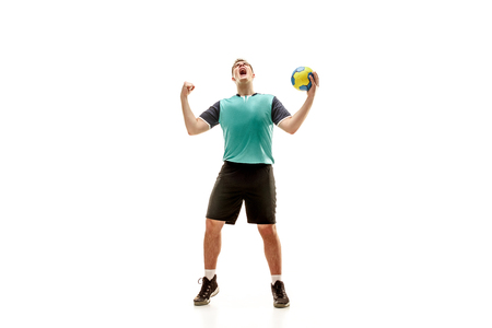 The happy fit caucasian young male handball player at studio on white background. Win , winner , human emotions concept
