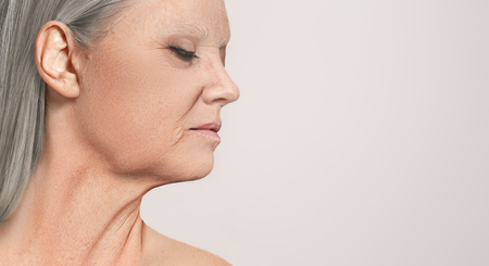 Portrait of beautiful senior woman. The profile view at studio with closed eyes Banco de Imagens
