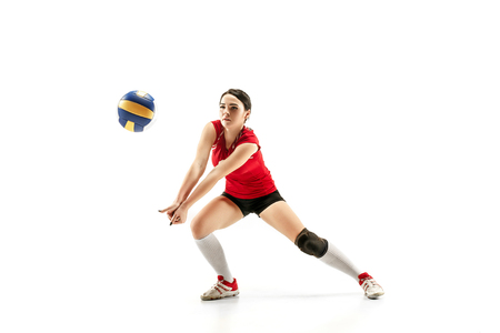 Female professional volleyball player isolated on white with ball.