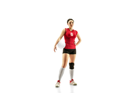 Female professional volleyball player isolated on white with ball. The athlete, exercise, action, sport, healthy lifestyle, training, fitness concept Фото со стока