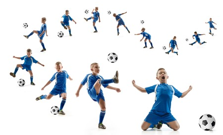 Young boy with soccer ball doing flying kick, isolated on white. football soccer players in motion on studio background. Fit jumping boy in action, jump, movement at game. Banco de Imagens