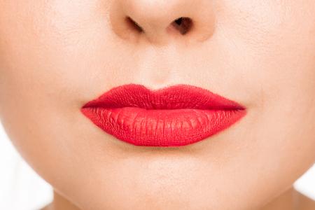 Sexy Red Lip. Close-up Beautiful lips. Make-up. Beauty Model Womans Face close-up Zdjęcie Seryjne