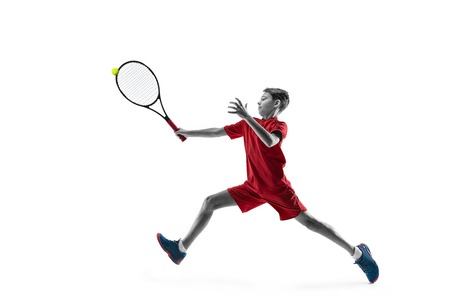 Young teen boy tennis player in motion or movement isolated on white studio Banque d'images - 115527507