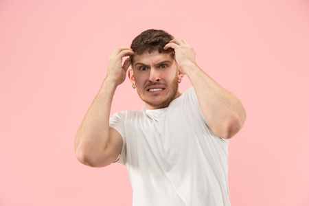 Why is that. Beautiful male half-length portrait isolated on trendy pink studio
