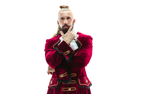 The young man wearing a traditional medieval costume of marquis posing at studio. Fantasy, Antique, Renaissance concept
