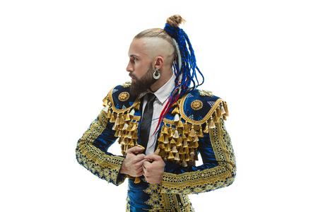 Torero in blue and gold suit or typical spanish bullfighter isolated over white studio background. The taming, achieving the goal, mortification, conquest, boss, leadership, battle, win, winner concept