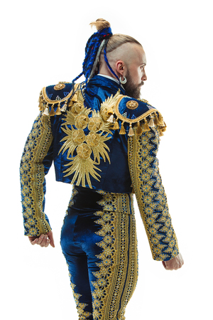 Torero in blue and gold suit or typical spanish bullfighter isolated over white studio