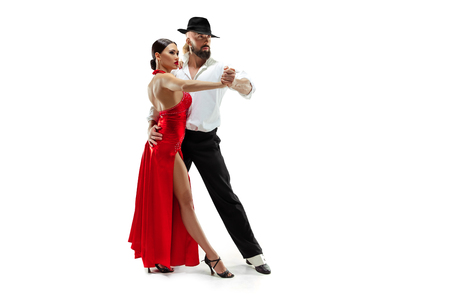 Portrait of young elegance tango dancers isolated over white Stock Photo