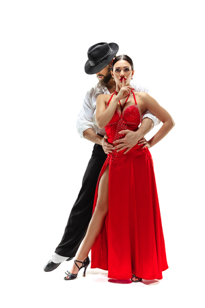 Portrait of young elegance tango dancers isolated over white