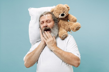 Tired man sleeping at home or office having too much work. Banque d'images - 115984645