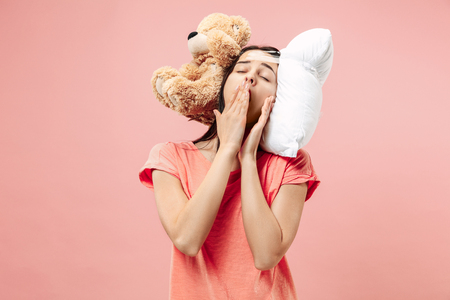 Tired happy woman sleeping at home or office having too much work. Bored businesswoman with pillow and toy bear. The busy, boring, worried, be late, concerned, sleep day, introuble concept Banque d'images - 116257256