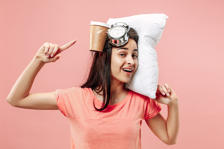 Tired happy woman with coffee at home or office having too much work. Bored businesswoman with pillow and coffee cups. The busy, boring, worried, be late, concerned, sleep day, introuble concept Stockfoto