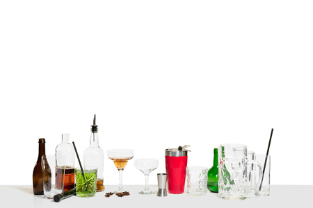 The many cocktails on the bar counter isolated on white. Nobody. International barman day, bar, alcohol, restaurant, party, pub, nightlife, cocktail, nightclub concept