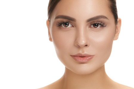 The beautiful female face. The perfect and clean skin of face on white. The beauty, care, skin, treatment, health, spa, cosmetic concept