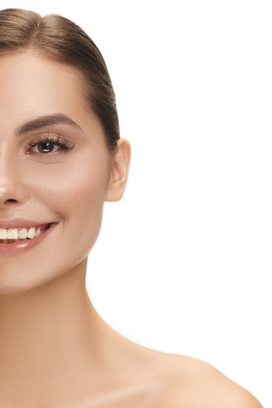 The beautiful happy smiling female face. The perfect and clean skin of face on white. The beauty, care, skin, treatment, health, spa, cosmetic concept