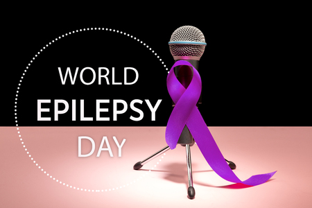 International or world Epilepsy Day concept. The text and a purple ribbon with microphone on a pink background. The health, breast, awareness, campaign, disease, help, care, support, hope, illness, survivor, healthcare concept