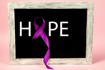 International or world Epilepsy Day concept. The text and a purple ribbon on a on advertising board. The health, breast, awareness, campaign, disease, help, care, support, hope, illness, survivor and healthcare concept Stock fotó