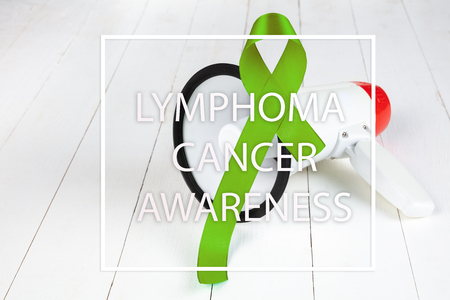Lime Green ribbon for Lymphoma Cancer and mental health awareness raising support and help patient living with illness. The cancer, health, breast, hope, illness, survivor and healthcare concept Stock Photo - 116286085