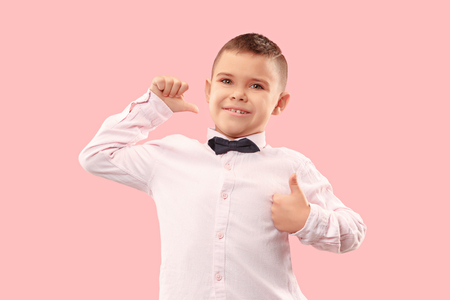 I won. Winning success happy man celebrating being a winner. Dynamic image of caucasian male model on pink studio background. Victory, delight concept. Human facial emotions concept. Trendy colors Stockfoto